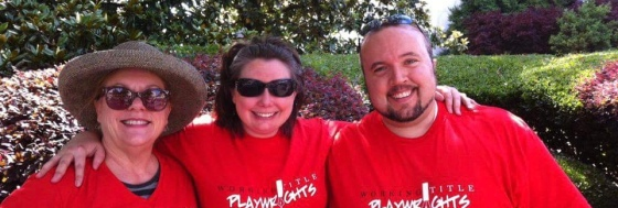 Members Christine Drescher-Jones, Kate and Daniel Guyton volunteer at the Decatur Arts Festival